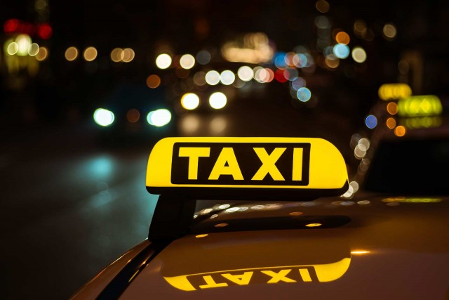 By taxi